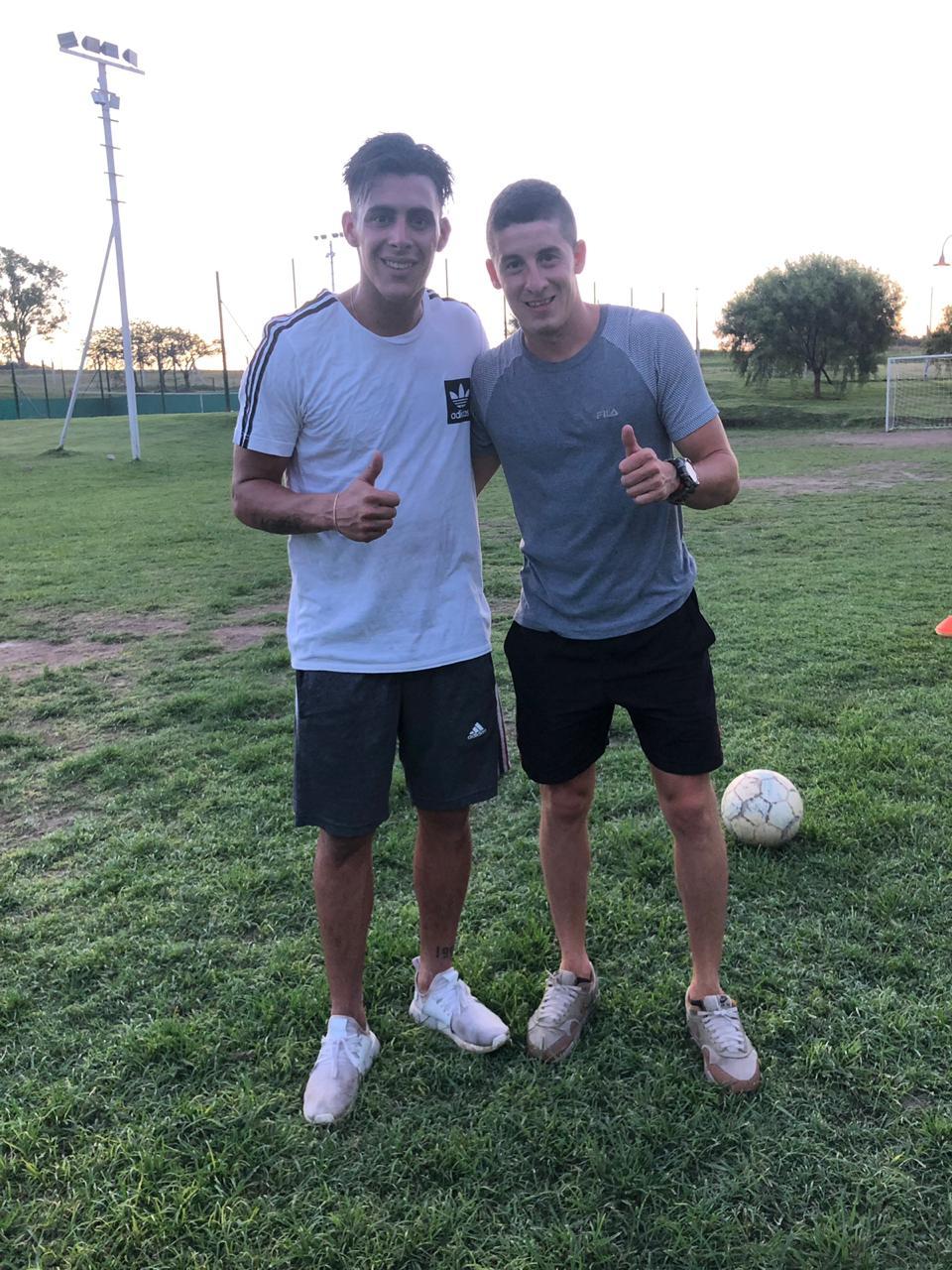 Cristian Pavón y Bruno Giacomelli al finalizar el entrenamiento